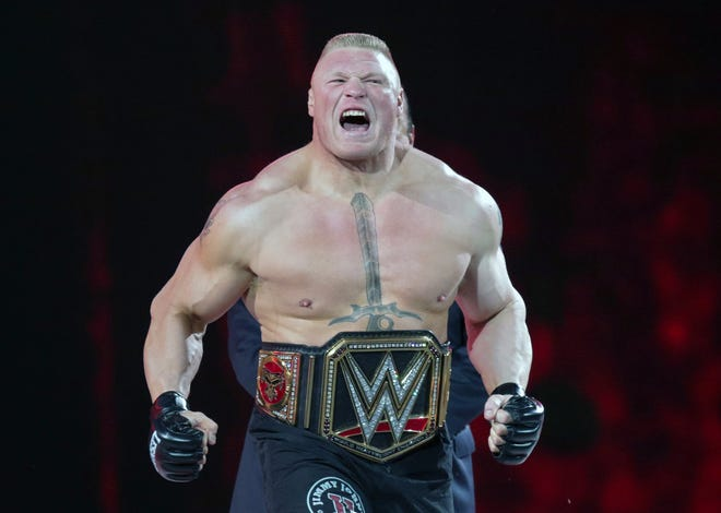 FILE - In this March 29, 2015, file photo, Brock Lesnar makes his entrance at Wrestlemania XXXI in Santa Clara, Calif. WWE held ts Crown Jewel event Friday, Nov. 2, 2018, in Riyadh, Saudi Arabia. The lucrative deal with Saudi Arabia has prompted fans and politicians to criticize WWE's decision to continue with the event. (AP Photo/Don Feria, File)