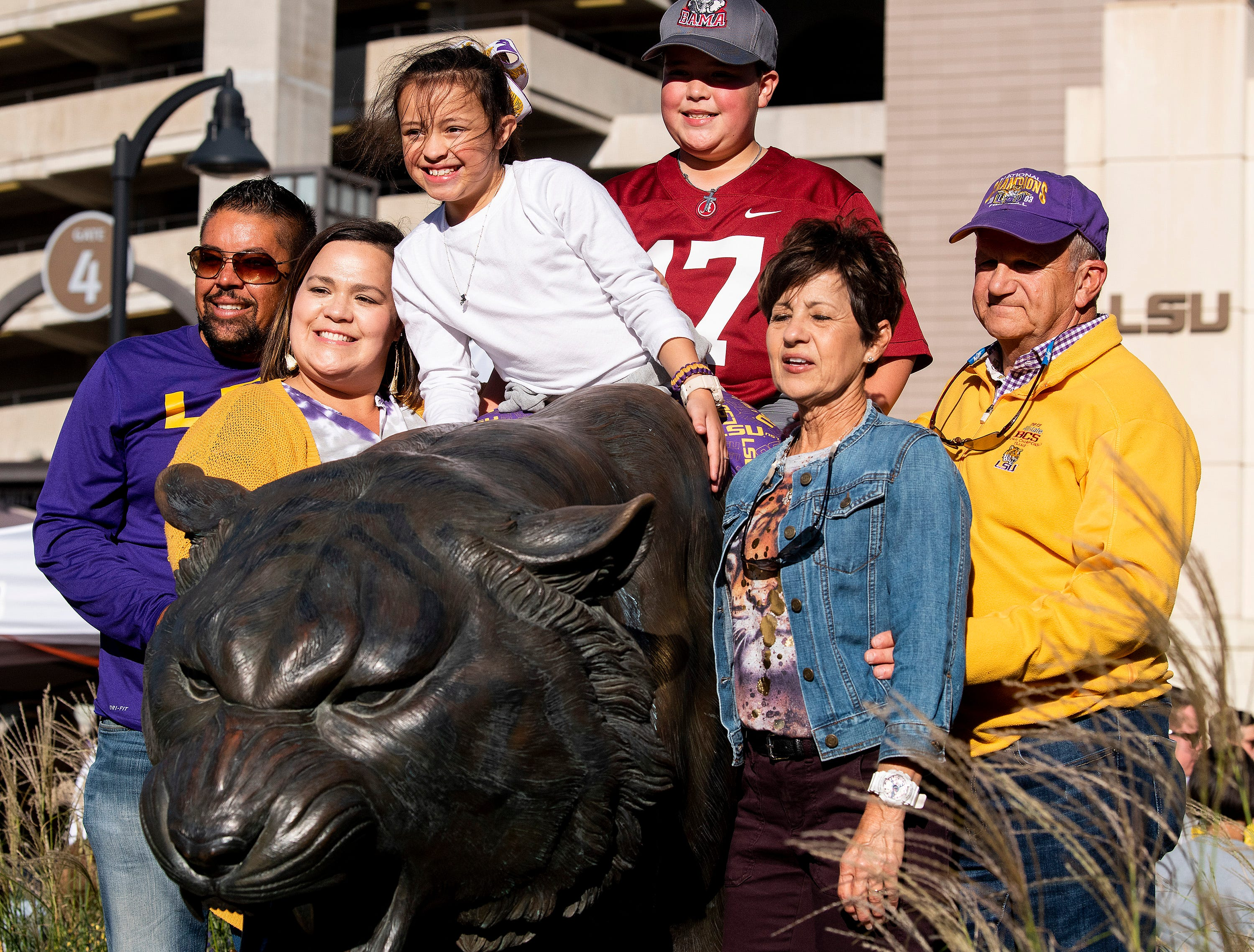 A family poses with the tiger before the Alabama vs. Louisiana State football game at Tiger Stadium in Baton Rouge, La., on Saturday November 3, 2018.
