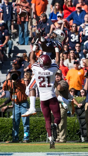 Auburn wide receiver Seth Williams (18) makes a leaping catch for a touchdown guarded by Texas A&M defensive back Charles Oliver (21) at Jordan-Hare Stadium on Saturday, Nov. 3, 2018. Texas A&M leads Auburn17-14 at halftime.