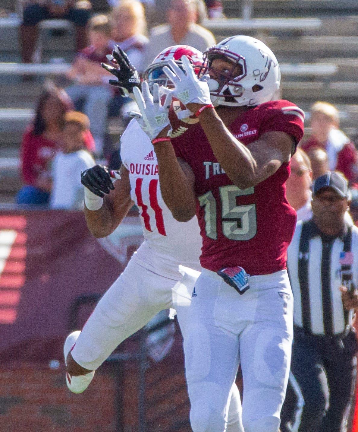 Troy's Damion Willis catches a pass over his shoulder during the first quarter.