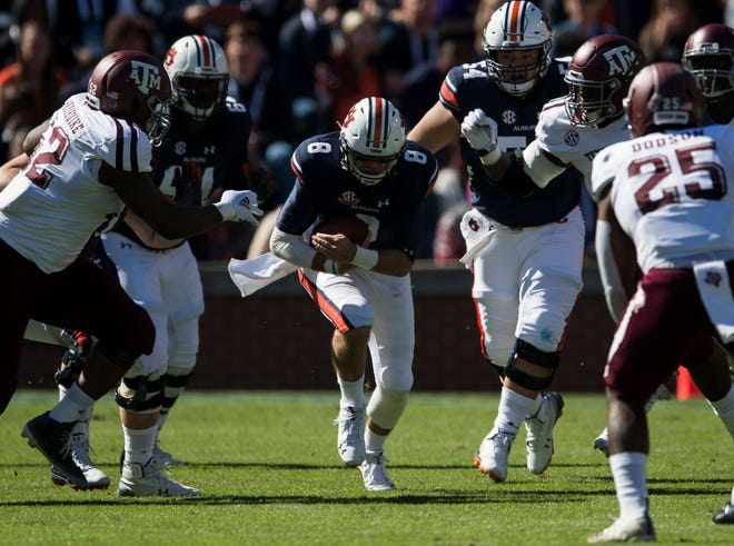 Auburn quarterback Jarrett Stidham (8) runs up the middle against Texas A&M at Jordan-Hare Stadium on Saturday, Nov. 3, 2018. Texas A&M leads Auburn17-14 at halftime.