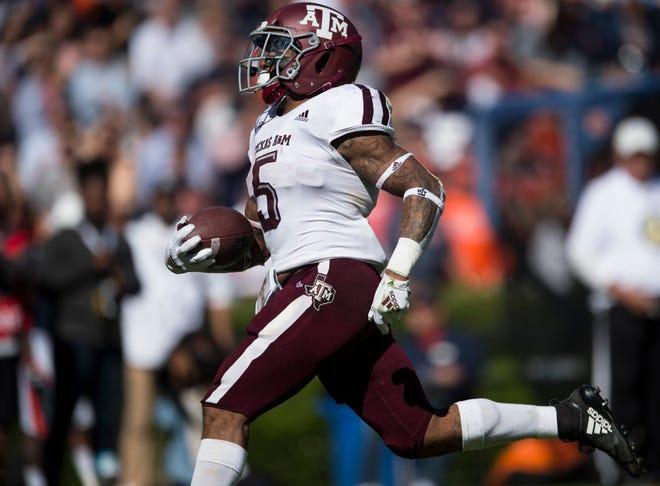 Texas A&M running back Trayveon Williams (5) breaks free for a touchdown run against  Auburn at Jordan-Hare Stadium on Saturday, Nov. 3, 2018. Texas A&M leads Auburn17-14 at halftime.