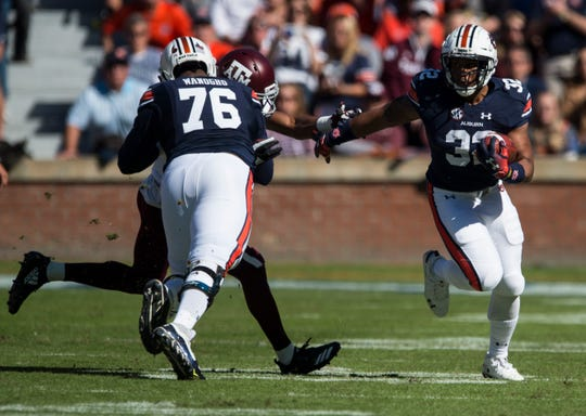 Auburn running back Malik Miller (32) runs the ball down field against Texas A&M at Jordan-Hare Stadium on Saturday, Nov. 3, 2018.