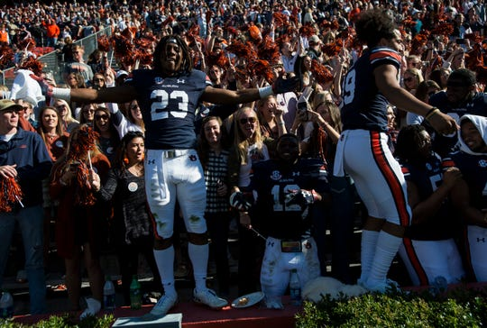 Auburn wide receiver Ryan Davis (23) celebrates with the fans after the game at Jordan-Hare Stadium on Saturday, Nov. 3, 2018. Auburn defeated Texas A&M 28-24.