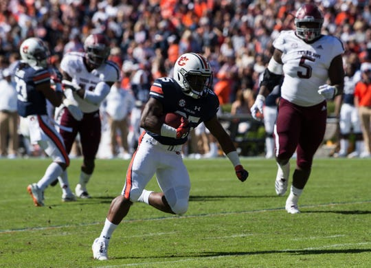 Auburn running back Shaun Shivers (25) runs the ball down field against Texas A&M at Jordan-Hare Stadium on Saturday, Nov. 3, 2018.