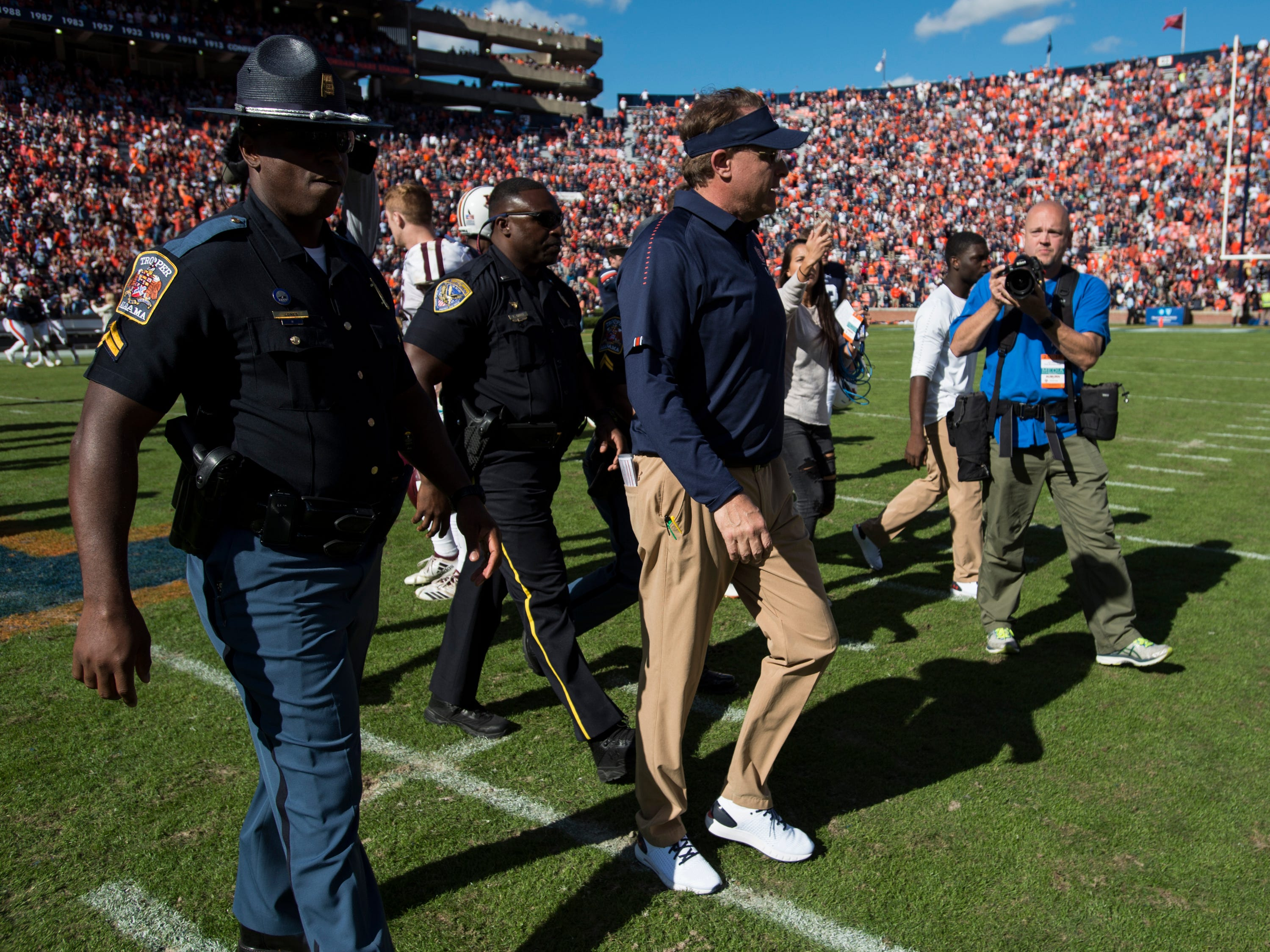 Auburn head coach Gus Malzahn walks to midfield after the game at Jordan-Hare Stadium on Saturday, Nov. 3, 2018. Auburn defeated Texas A&M 28-24.