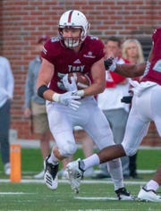 Troy's Kyler Knudsen runs the ball after an interception in the fourth quarter against the Ragin' Cajuns.