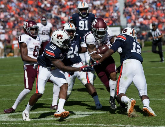Texas A&M running back Trayveon Williams (5) pushes through Auburn defenders to get into the end zone for a touchdown at Jordan-Hare Stadium on Saturday, Nov. 3, 2018. Texas A&M leads Auburn17-14 at halftime.