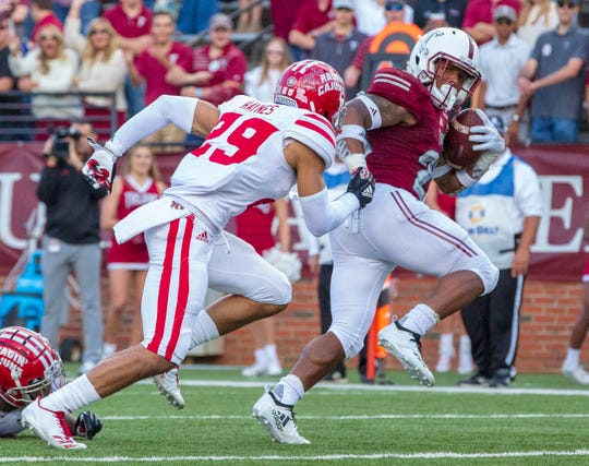 Troy's B.J. Smith looks over his shoulder as the Ragin' Cajuns' Koa Haynes remains hot on his heels.