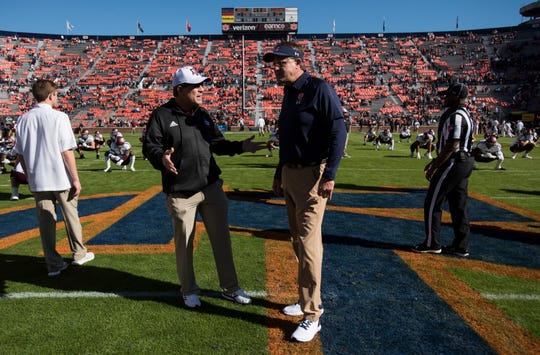 Texas A&M head coach Jimbo Fisher and Auburn head coach Gus Malzahn talk at midfield before the game at Jordan-Hare Stadium on Saturday, Nov. 3, 2018.