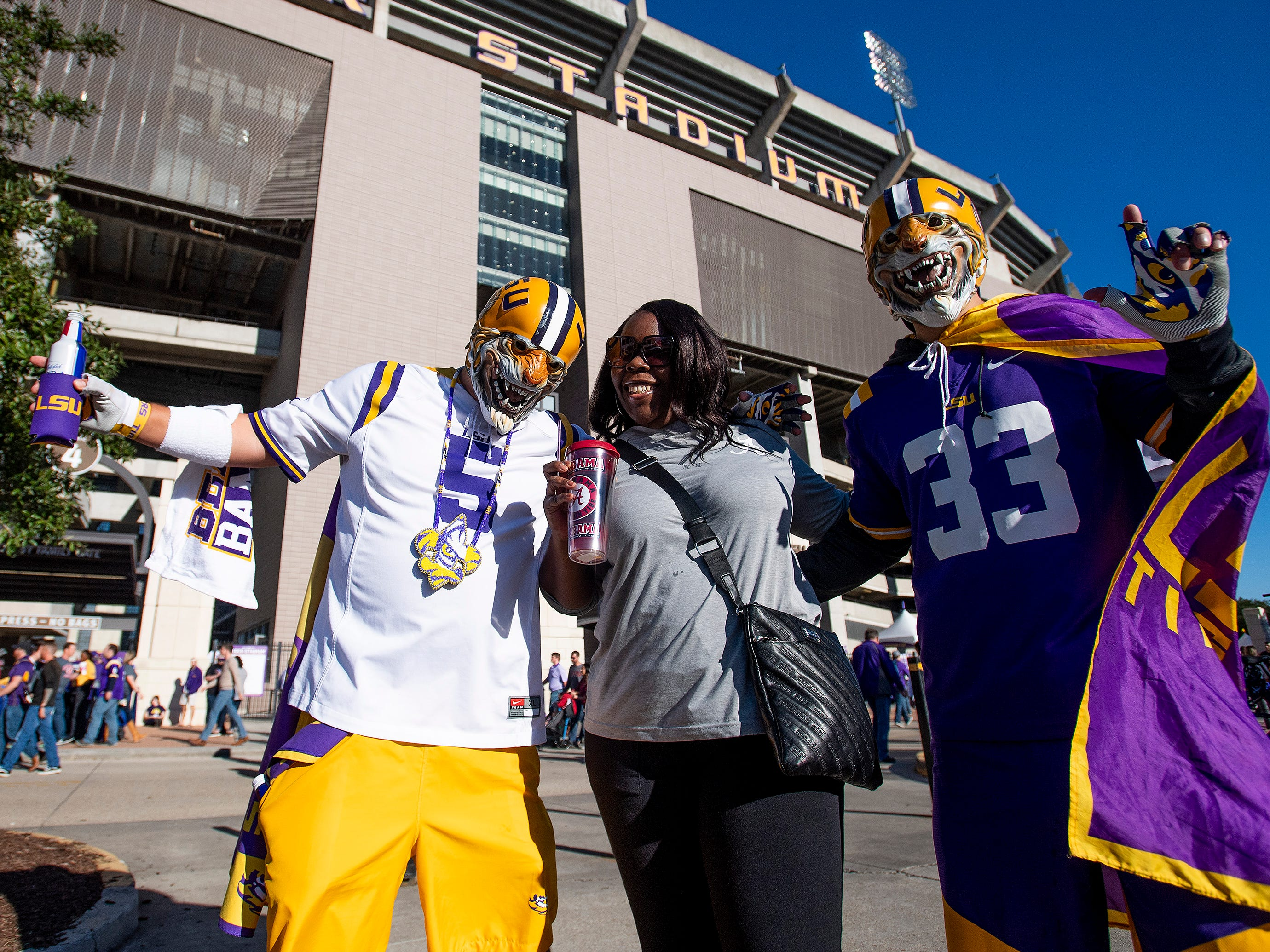 Alabama fan Terita Patterson is greeted by LSU fans before the Alabama vs. Louisiana State football game at Tiger Stadium in Baton Rouge, La., on Saturday November 3, 2018.