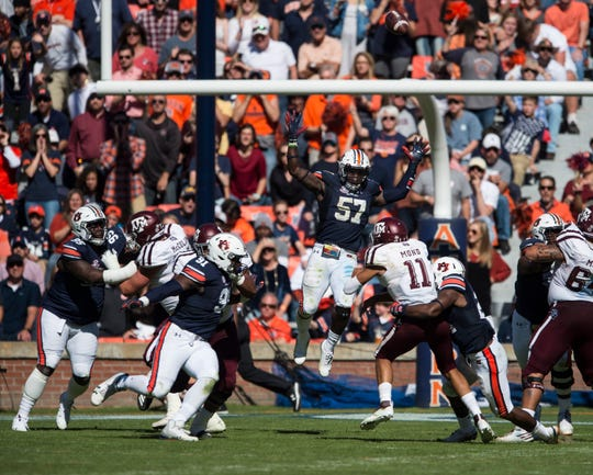 Texas A&M quarterback Kellen Mond (11) pass is tipped as he is hit by Auburn defensive back Daniel Thomas (24) at Jordan-Hare Stadium on Saturday, Nov. 3, 2018. A defensive pass interference penalty was called on the play. Auburn defeated Texas A&M 28-24.