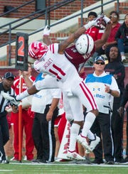 Troy's Damion Willis snatches the ball out of the air with one hand on a wild pass. It was his final catch in a 213-yard effort that ranks second in school history.
