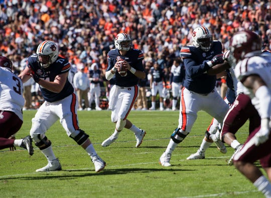 Auburn quarterback Jarrett Stidham (8) looks to make a pass against Texas A&M at Jordan-Hare Stadium on Saturday, Nov. 3, 2018.