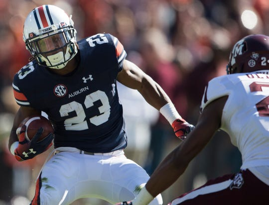 Auburn wide receiver Ryan Davis (23) attempts to juke Texas A&M defensive back Charles Oliver (21) on a big fourth-quarter catch at Jordan-Hare Stadium on Saturday, Nov. 3, 2018. Auburn defeated Texas A&M 28-24.