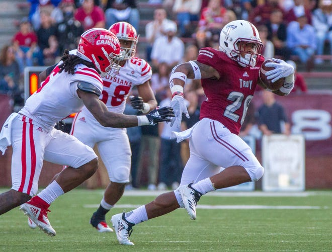 Troy's B.J. Smith hustles from a tackle during the first half against the Ragin' Cajuns.