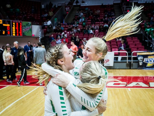 New Castle celebrates their 3-0 state win over Northview at Worthen Arena Saturday, Nov. 3, 2018.