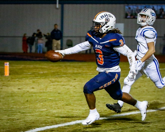 The outstretched arm of Tamicus Napier puts the ball in the end zone giving Blackman the first score of the night against Lebanon.
