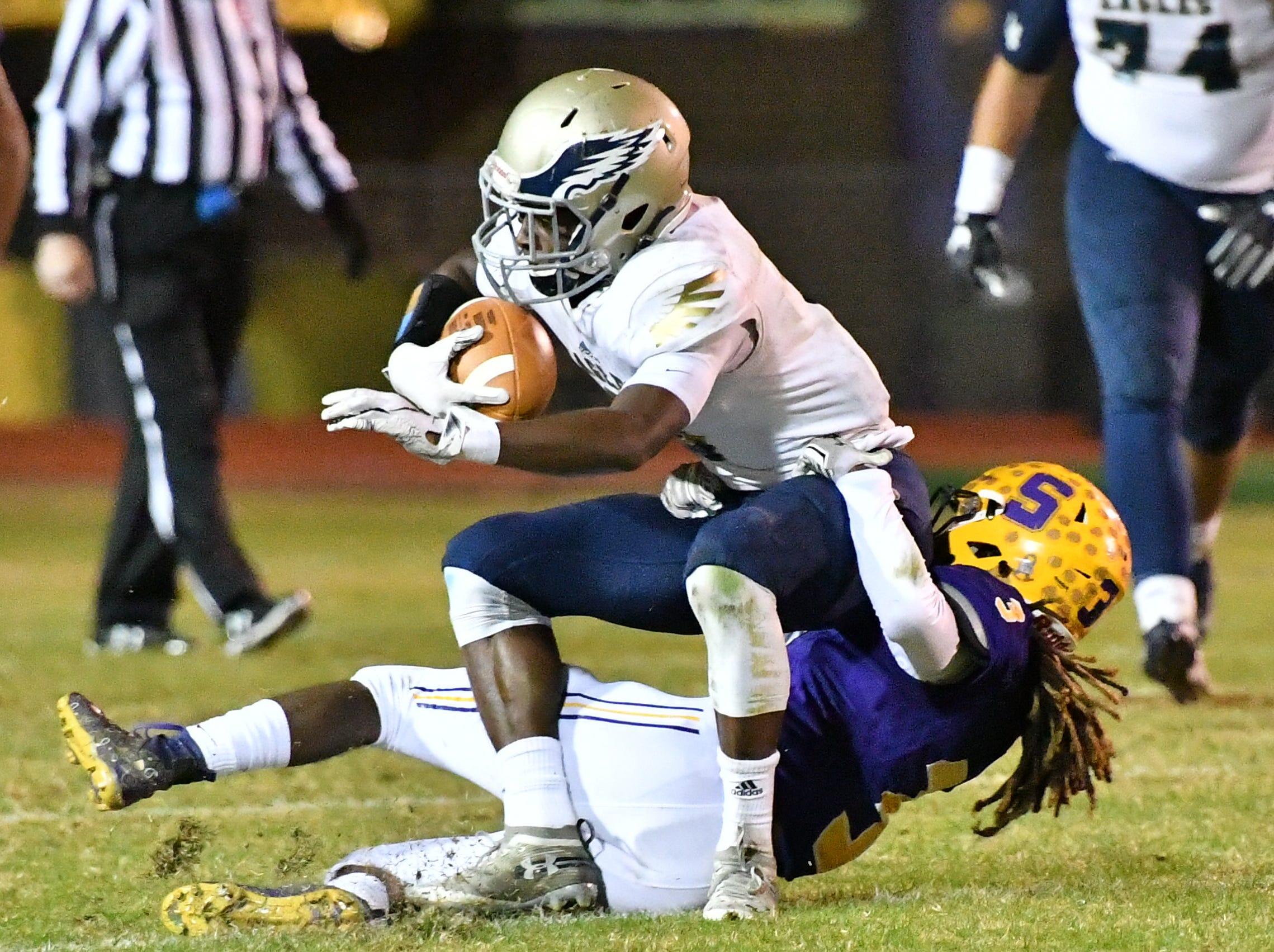 Independence's Isaiah Collier is brought down by Smyrna's Da'shawn Moore during Friday's 33-14 Eagles win.