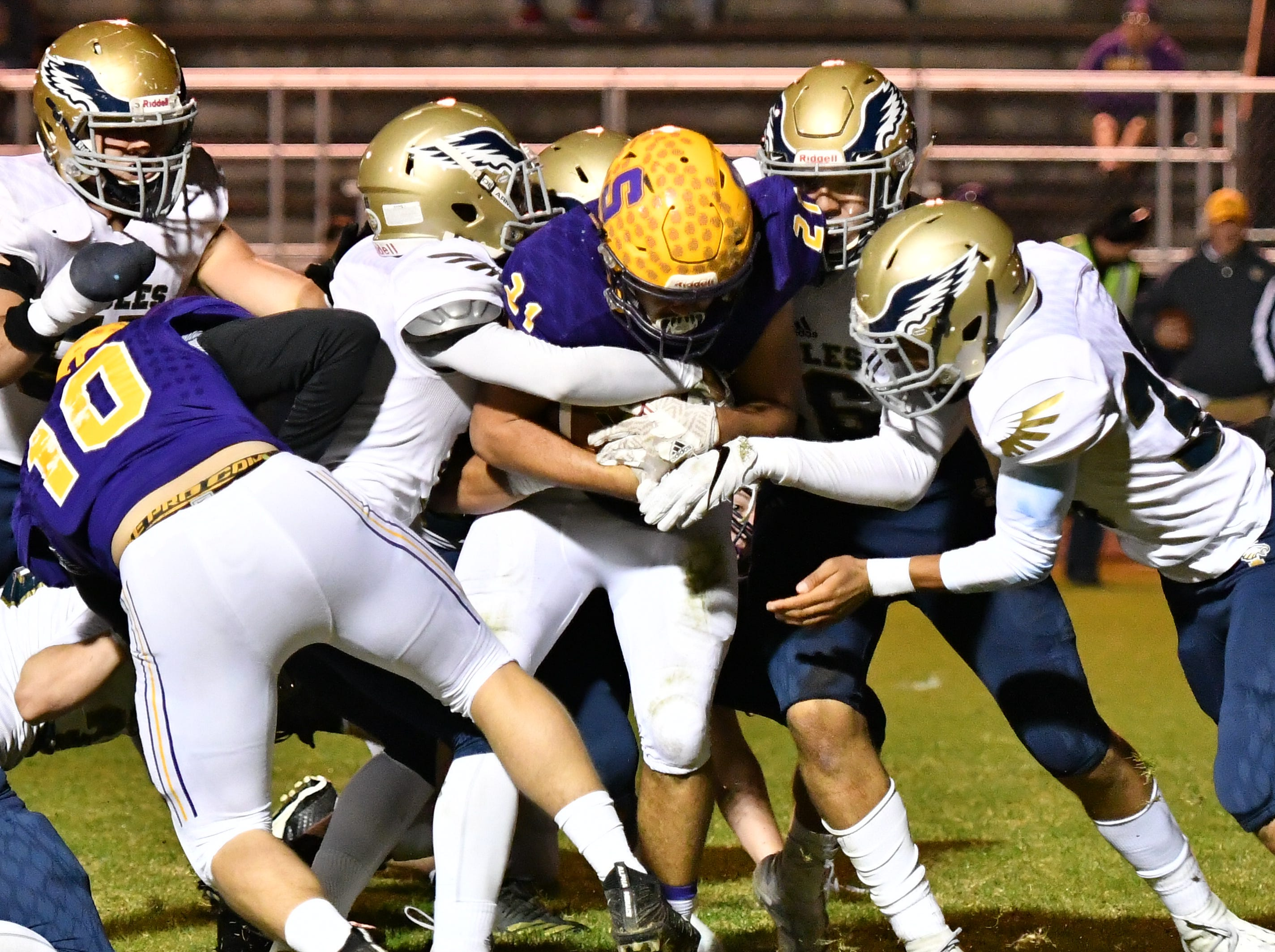 Independence defenders wrap up Smyrna's Blake Watkins during Friday's 33-14 Eagles win.