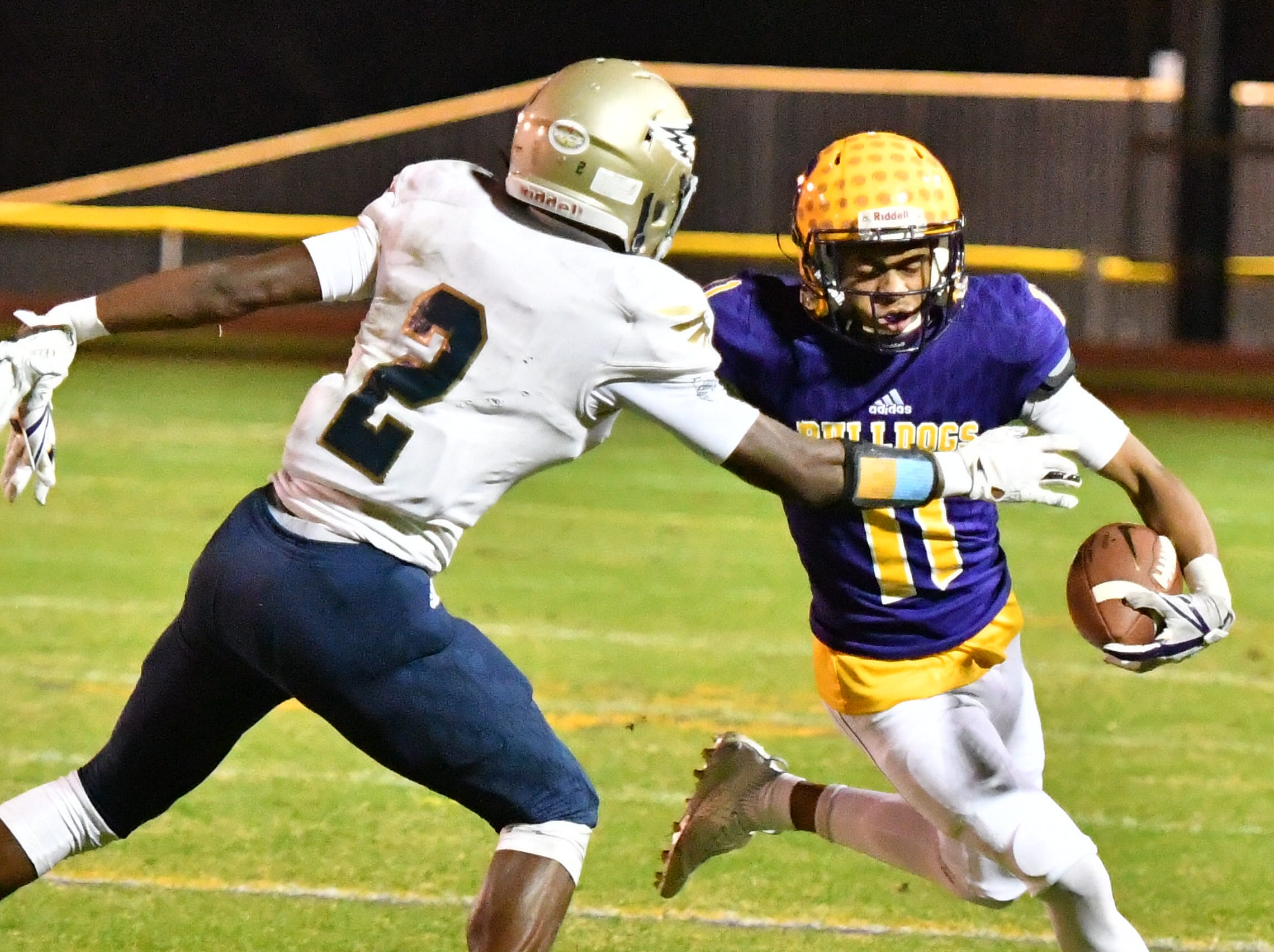 Smyrna's Tyler Lansden looks for running room after a catch as Independence's T.J. Sheffield prepares for a tackle Friday.