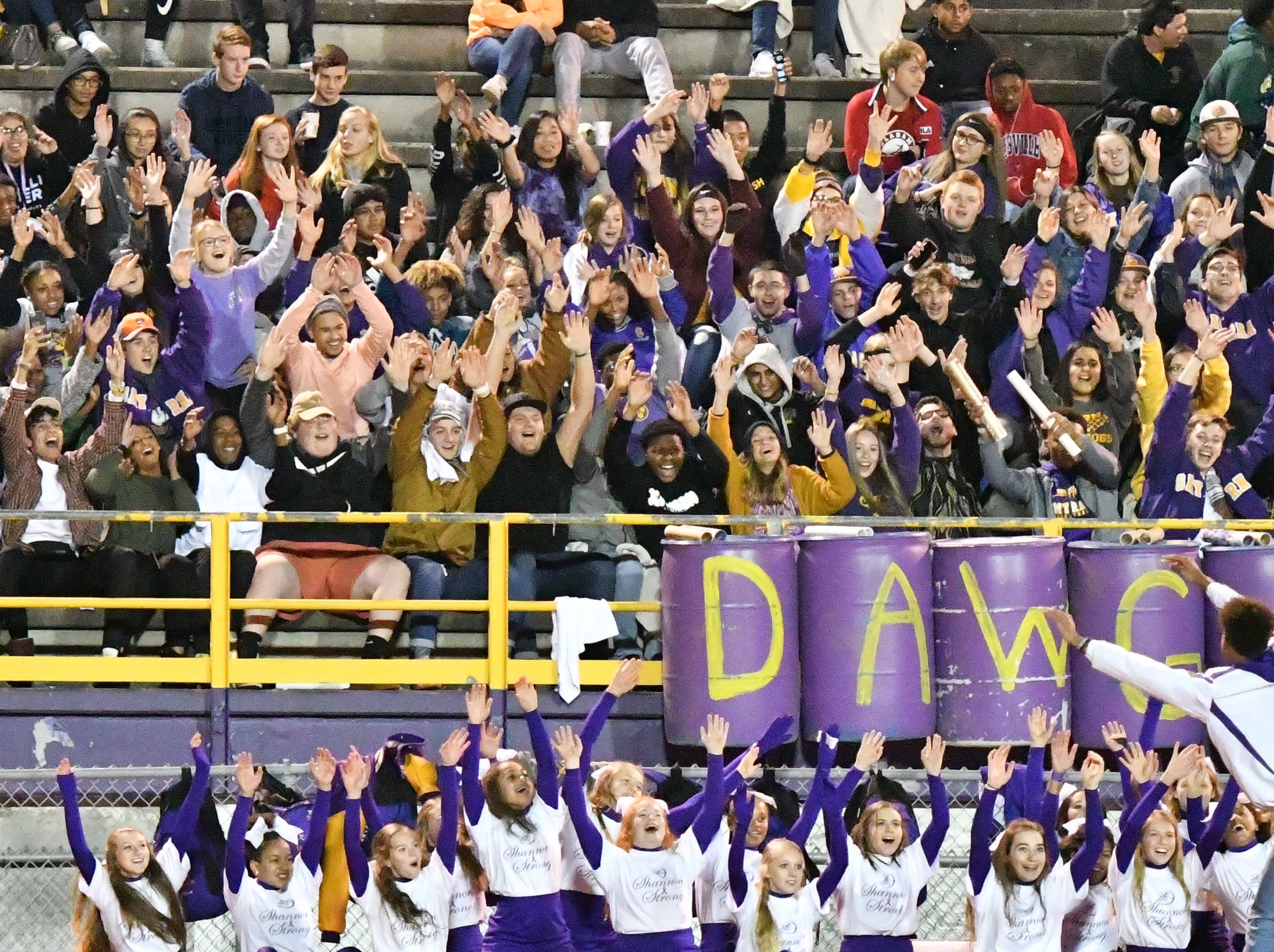 Smyrna fans cheer on the Bulldogs during Friday's playoff loss to Independence..