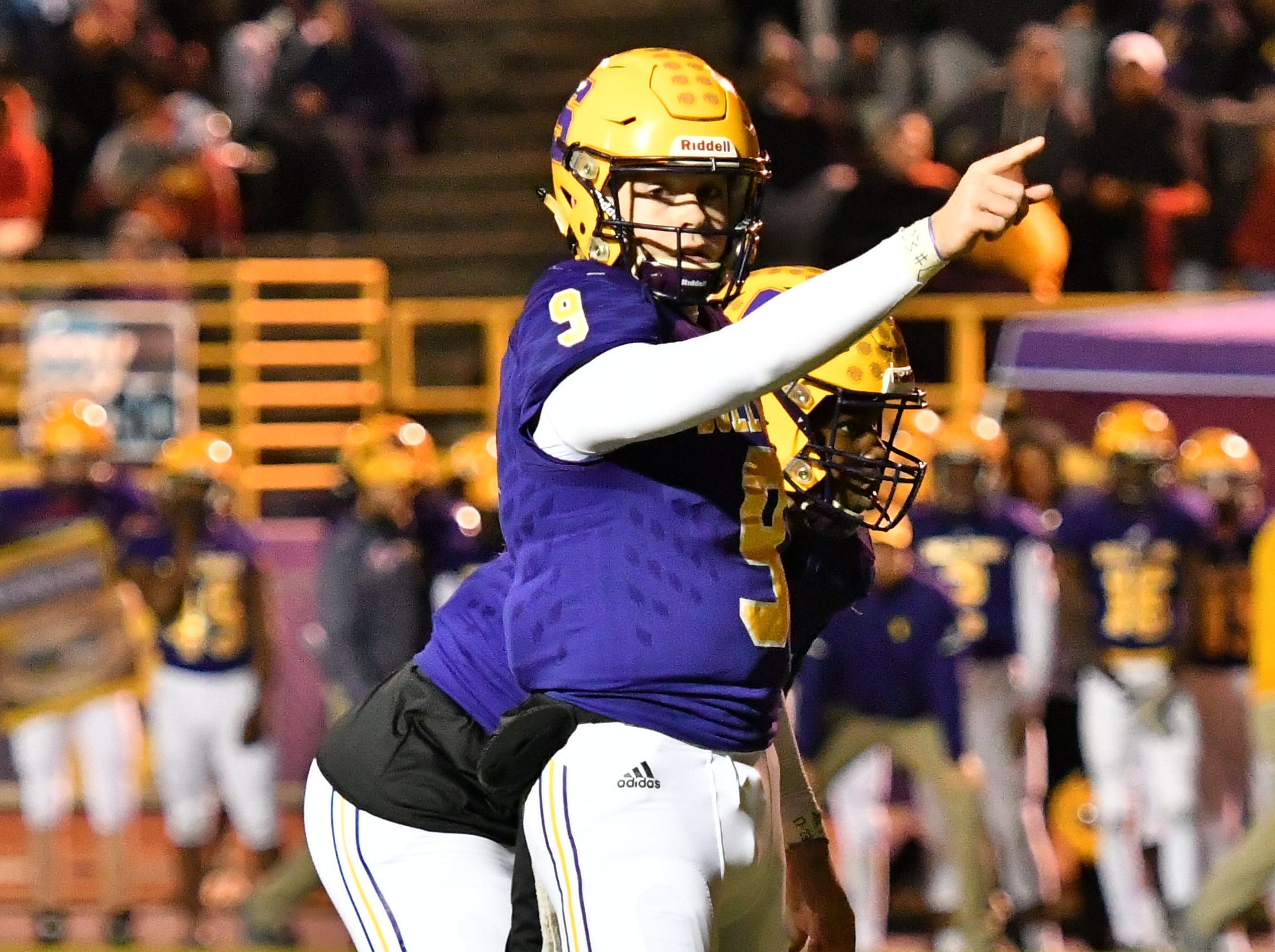 Smyrna QB Alex Bannister signals a play during Friday's 33-14 loss to Independence.
