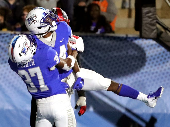 MTSU's Patrick Smith (37) lifts up Zack Dobson after Dobson scores a touchdown against Western Kentucky at MTSU on Friday, Nov. 2, 2018.