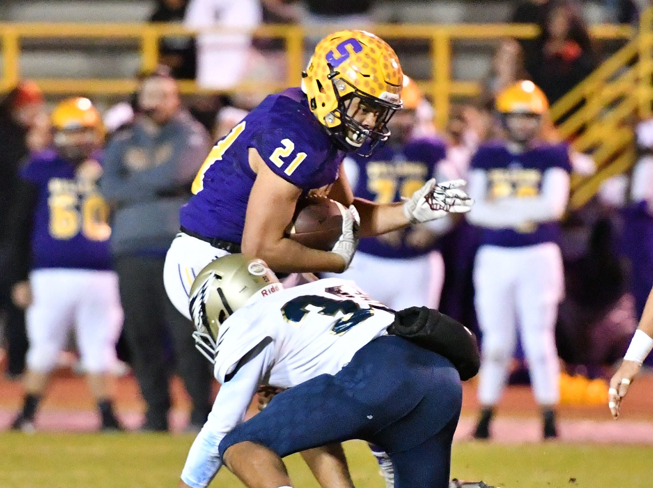 Smyrna's Blake Watkins is wrapped up by Independence's Jaxson Campbell Friday.