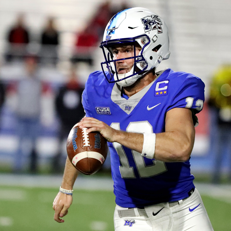 MTSU's quarterback Brent Stockstill (12) runs the option against Western Kentucky at MTSU on Friday, Nov. 2, 2018.