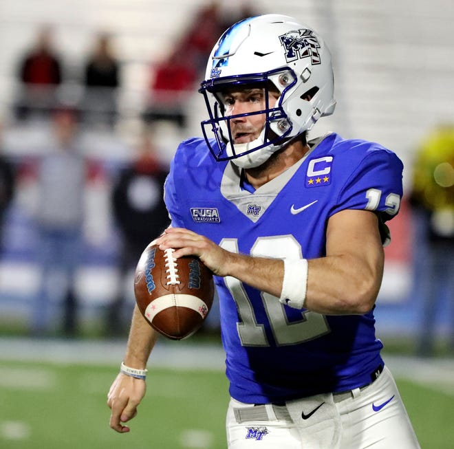 MTSU's quarterback Brent Stockstill (12) runs the option against Western Kentucky at MTSU on Friday, Nov. 2, 2018.