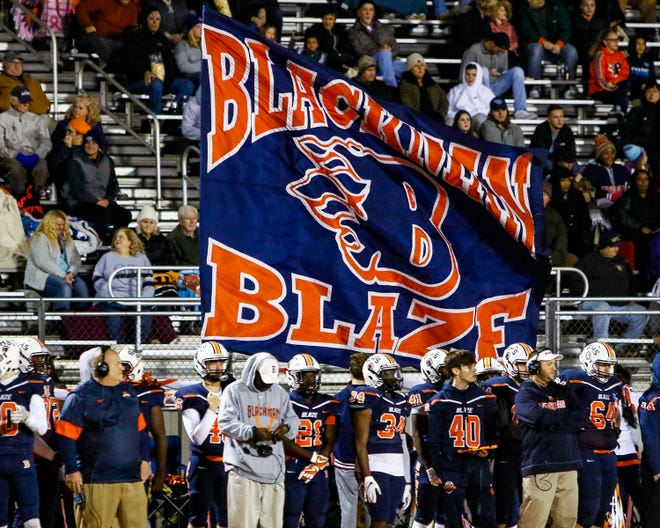 Blackman fans cheer during their team's game with Lebanon.  Blackman won 44-7.