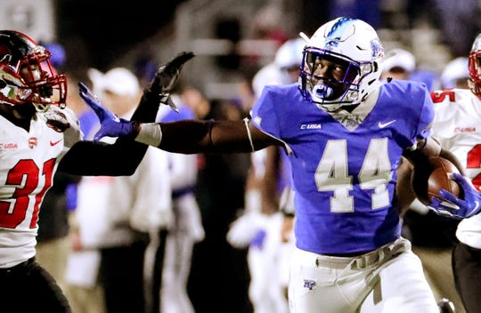 MTSU's Chaton Mobley (44) runs the ball as Western Kentucky's Antwon Kincade (31) moves in for a tackle during the game at MTSU on Friday, Nov. 2, 2018.