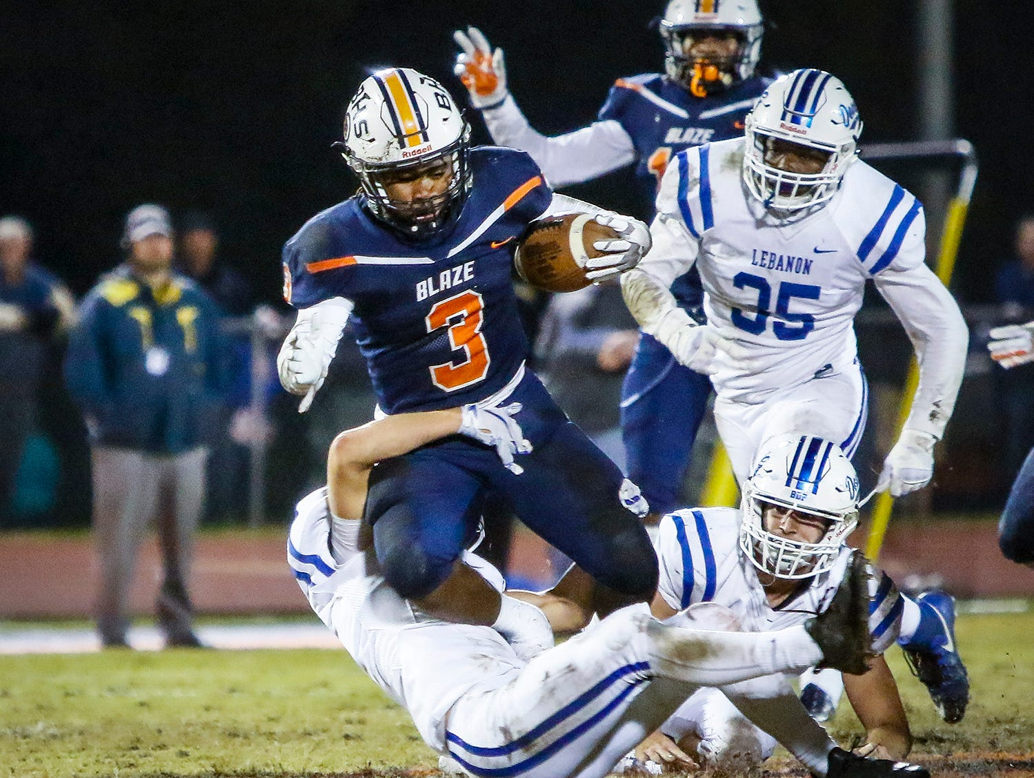 Lebanon's Levi Sampson tackles Blackman's Tamicus Napier during Friday's 6A playoff game.