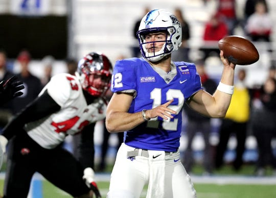 MTSU's quarterback Brent Stockstill (12) looks for an open player during the game against Western Kentucky at MTSU on Friday, Nov. 2, 2018.