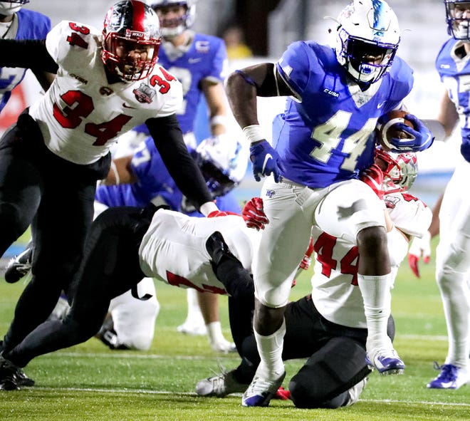 MTSU's Chaton Mobley (44) runs the ball against Western Kentucky during the game at MTSU on Friday, Nov. 2, 2018.