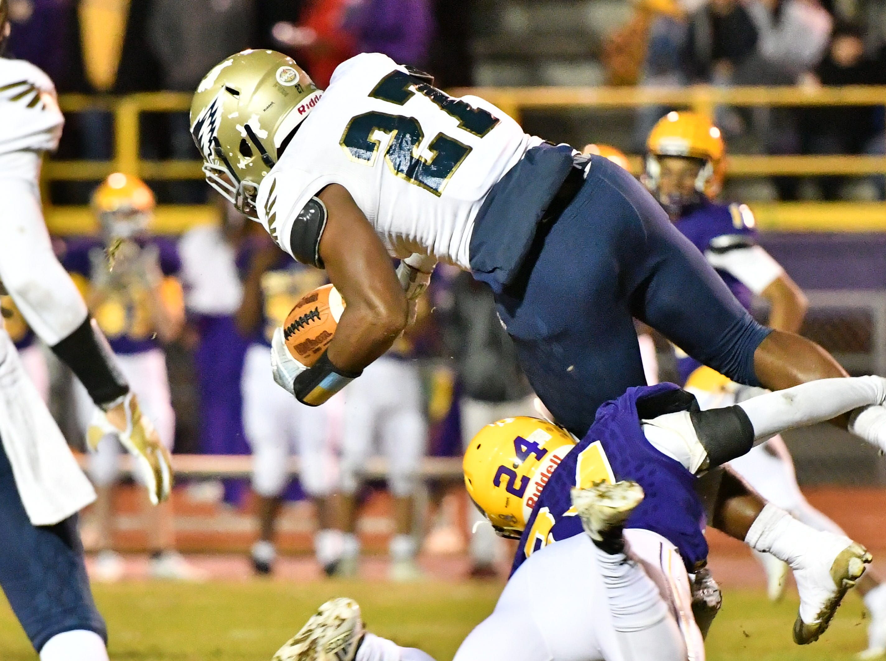 Independence running back Tyrus Jackson leaps over Smyrna's Austin Guidry during Friday's 33-14 Eagles win.