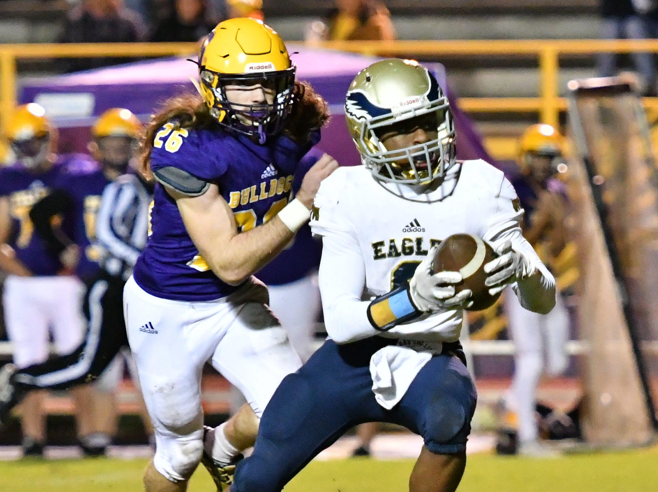 Independence's Isaiah Collier tries to elude Smyrna defenders, including Gaven Howell (26) Friday.