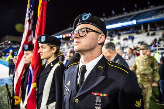 Blue Raider Battalion members in MTSU's ROTC program present the colors in a ceremony before the MTSU-Western Kentucky college football game at Floyd Stadium Nov. 2. It was part of the 37th annual Salute to Veterans and Armed Forces.