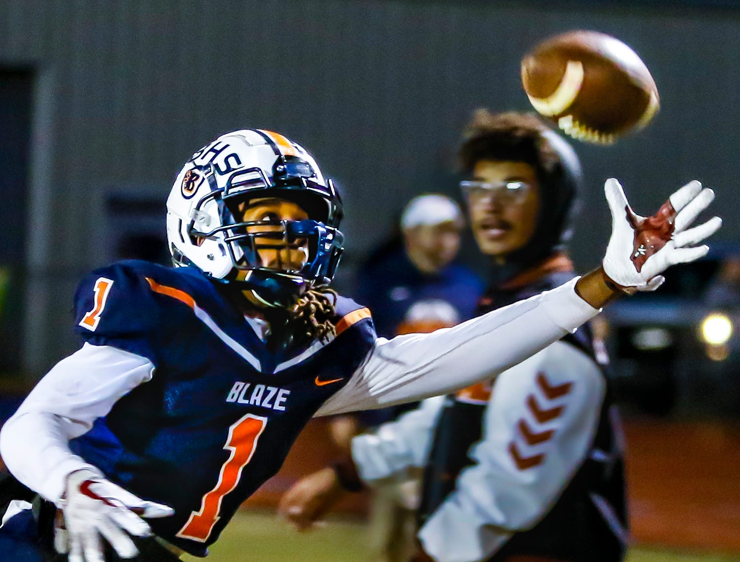 Blackman's Adonis Otey stretches for a pass completion.  Blackman defeated Lebanon 44-7 in the first round of the 6A playoffs.