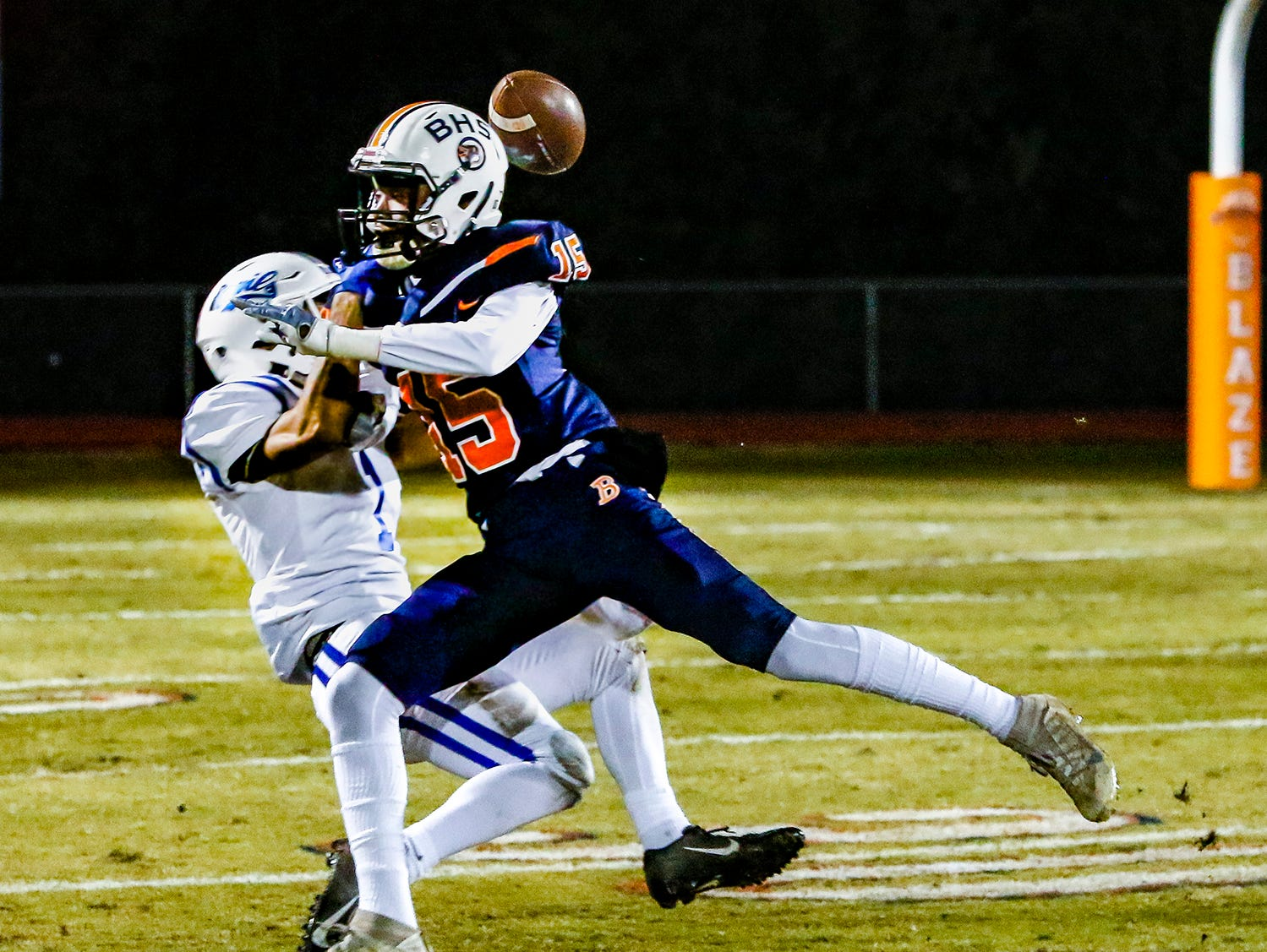 Blackman's William Camden puts a big hit on Lebanon's Tyson Kelley, preventing a pass reception.