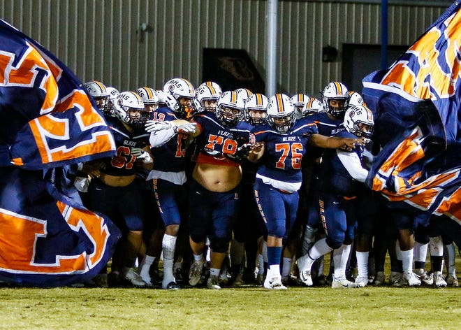 Blackman players enter the field prior to Friday's 6A playoff win over Lebanon.