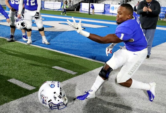 After beating Western Kentucky MTSU's Terelle West (1) rolls his helmet into his teammates to show that with the win against Western that they are now bowl eligible on Friday, Nov. 2, 2018.