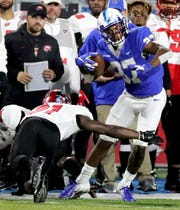 MTSU's Patrick Smith (37) makes a catch and runs the ball as Western Kentucky's Antwon Kincade (31) moves in for a tackle during the game at MTSU on Friday, Nov. 2, 2018.