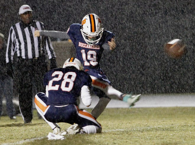 Beech's Cory Edwards boots an extra point in the rain against Summit on Friday, November 2, 2018.