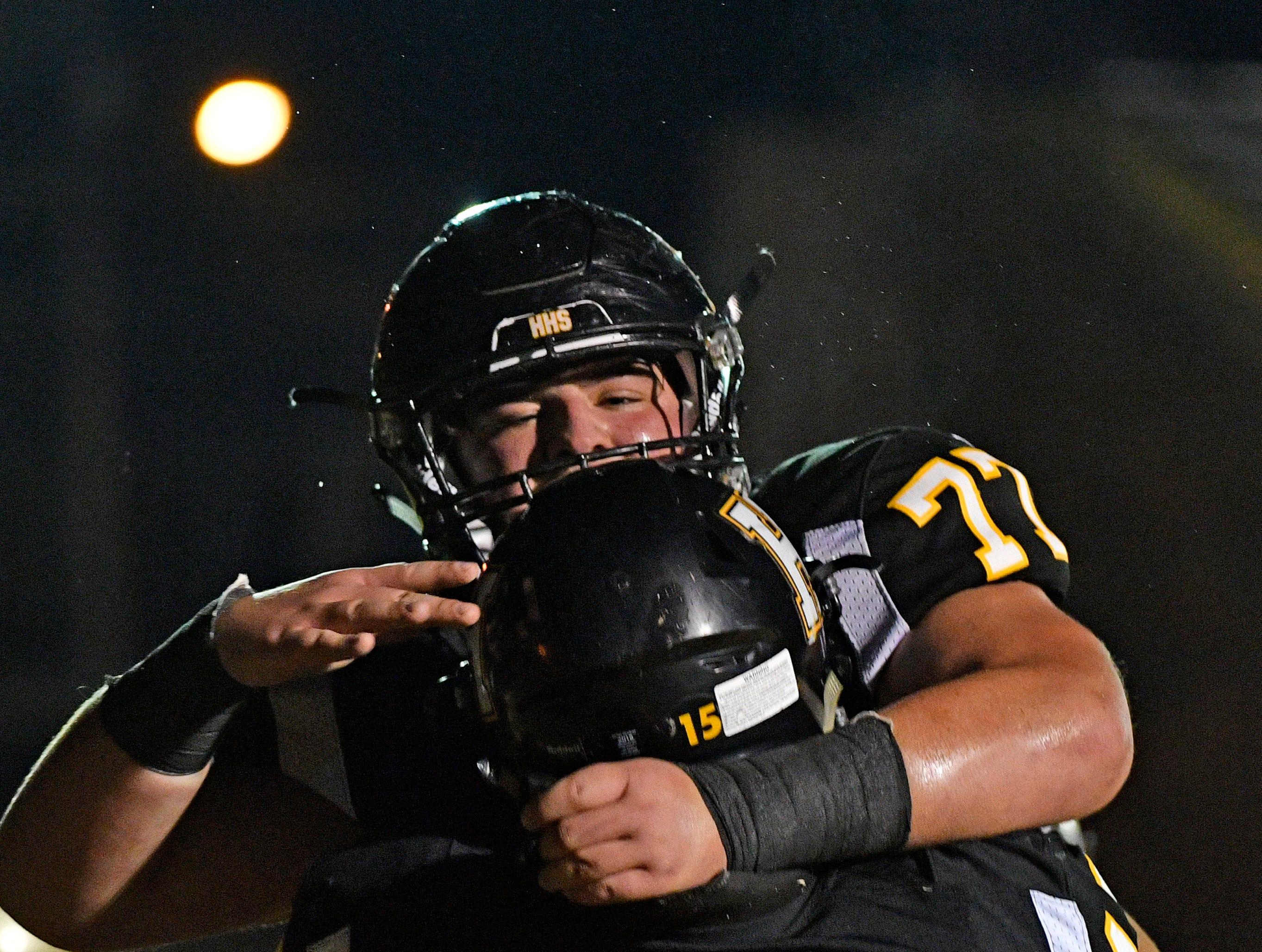 Dalton Jones  is congratulated for his touchdown by teammate Austin Hamblin as Riverdale plays at Hendersonville Friday Nov. 2, 2018, in Hendersonville, Tenn.