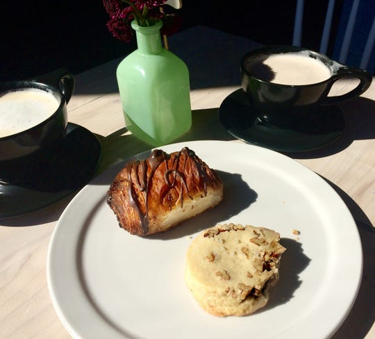 Café au laits, chocolate croissant and pecan sandy at Slow Hand Coffee + Bakeshop in East Nashville.