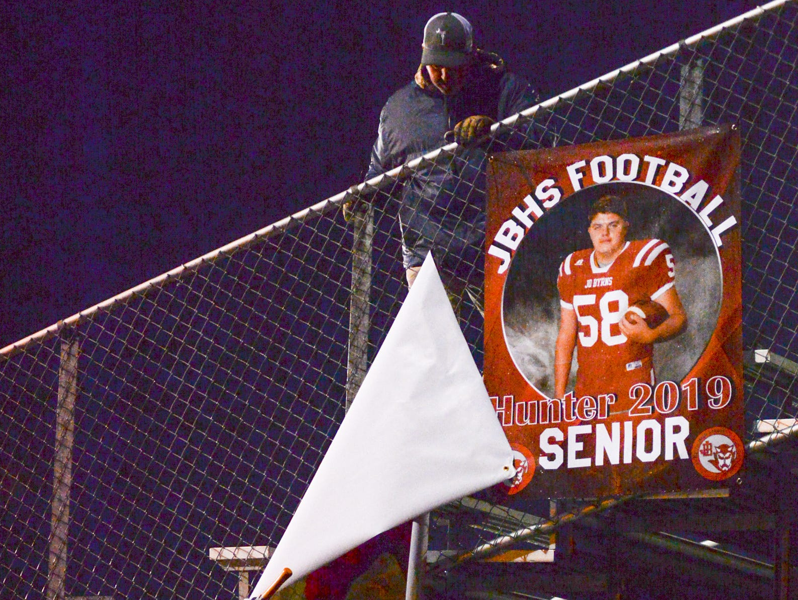 Jo Byrns High School takes down player signs after a loss to Lookout Valley to end their season at Jo Byrns High School on Friday, Nov. 2.