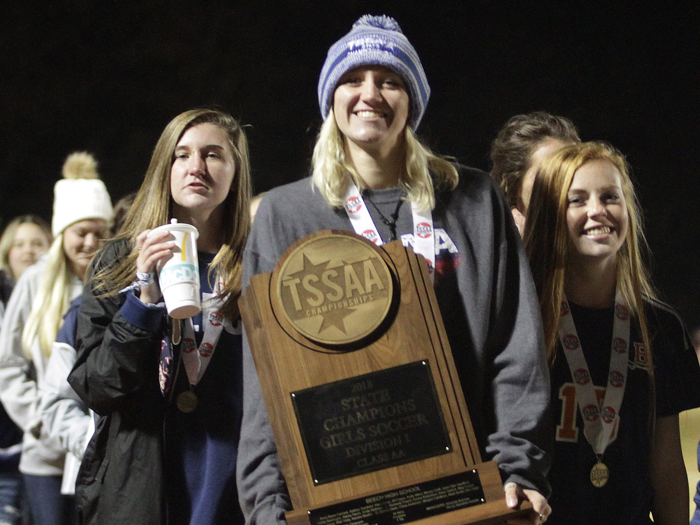 Beech's Kendra Mueller walks off the field holding their State Soccer Championship trophy at halftime of the Summit at Beech football game on Friday, November 2, 2018.