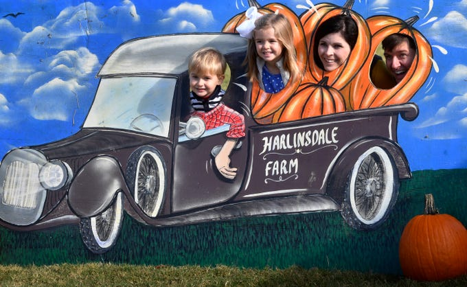 Gavin, Miriam, Anna and Craig Wright pose for a family photo during Family Day at the Park at Harlinsdale Farms Saturday Nov. 3, 2018, in Franklin, Tenn.